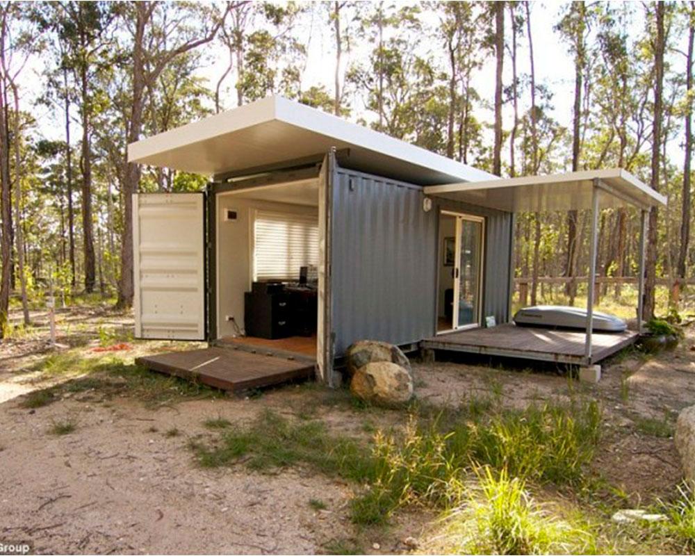 cabaña en bosque con container
